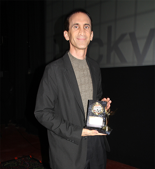 Photo of Gregory Blair & award at the Lucky Strike Film Festival